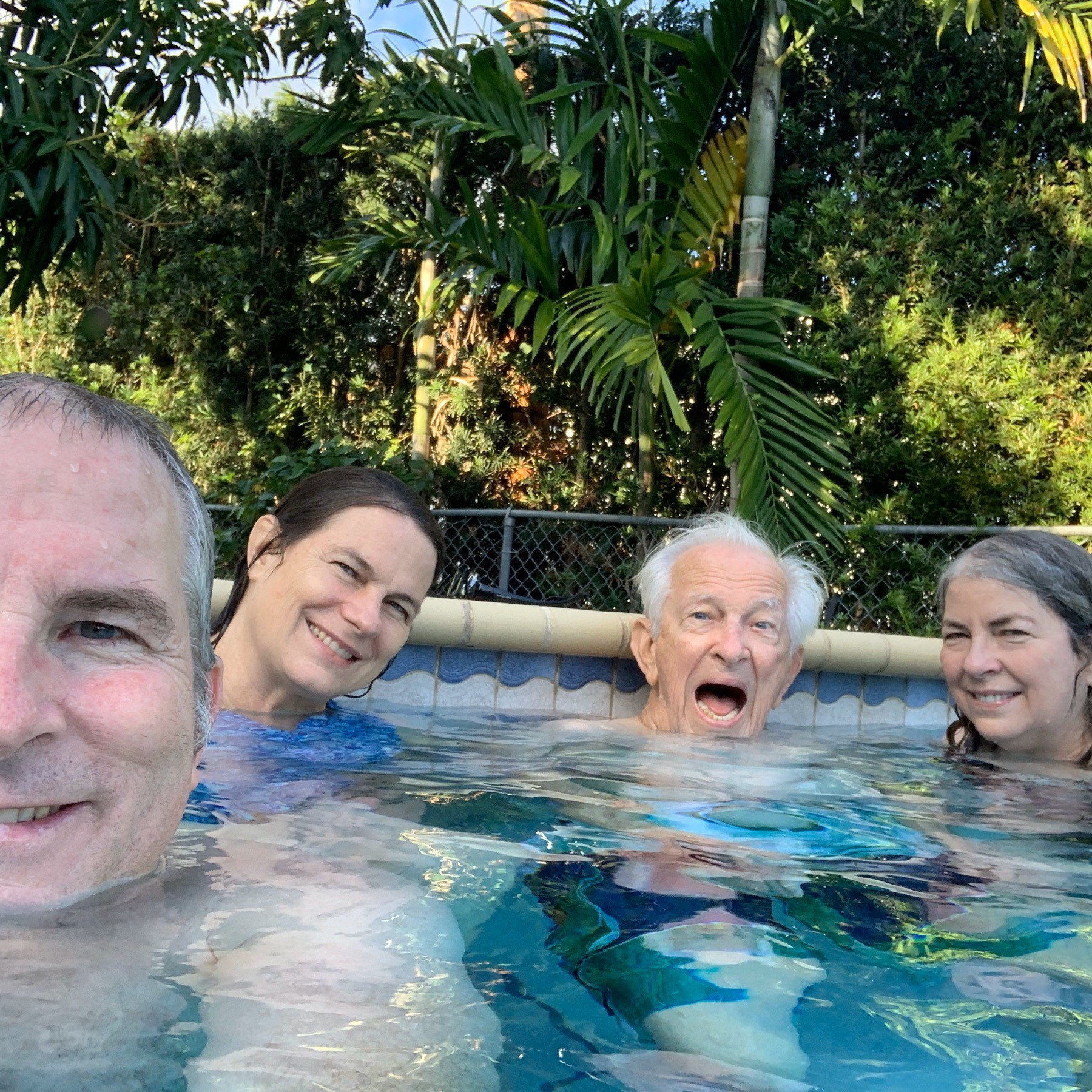 Siblings and dad in the pool