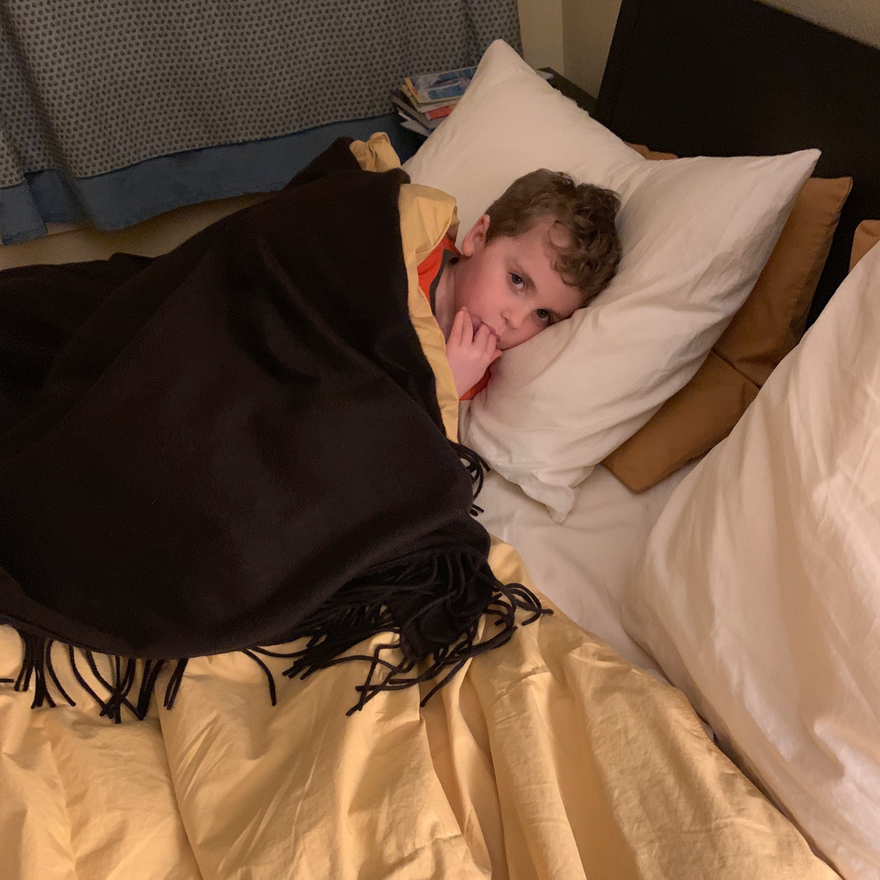 nephew cozy in bed