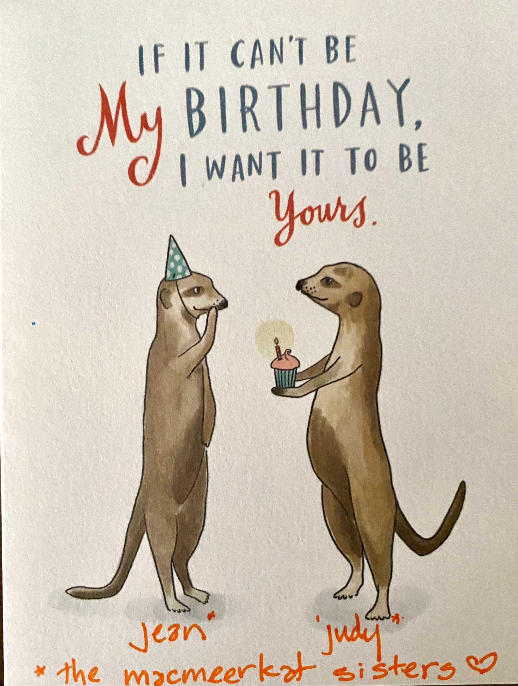birthday card featuring two meerkats