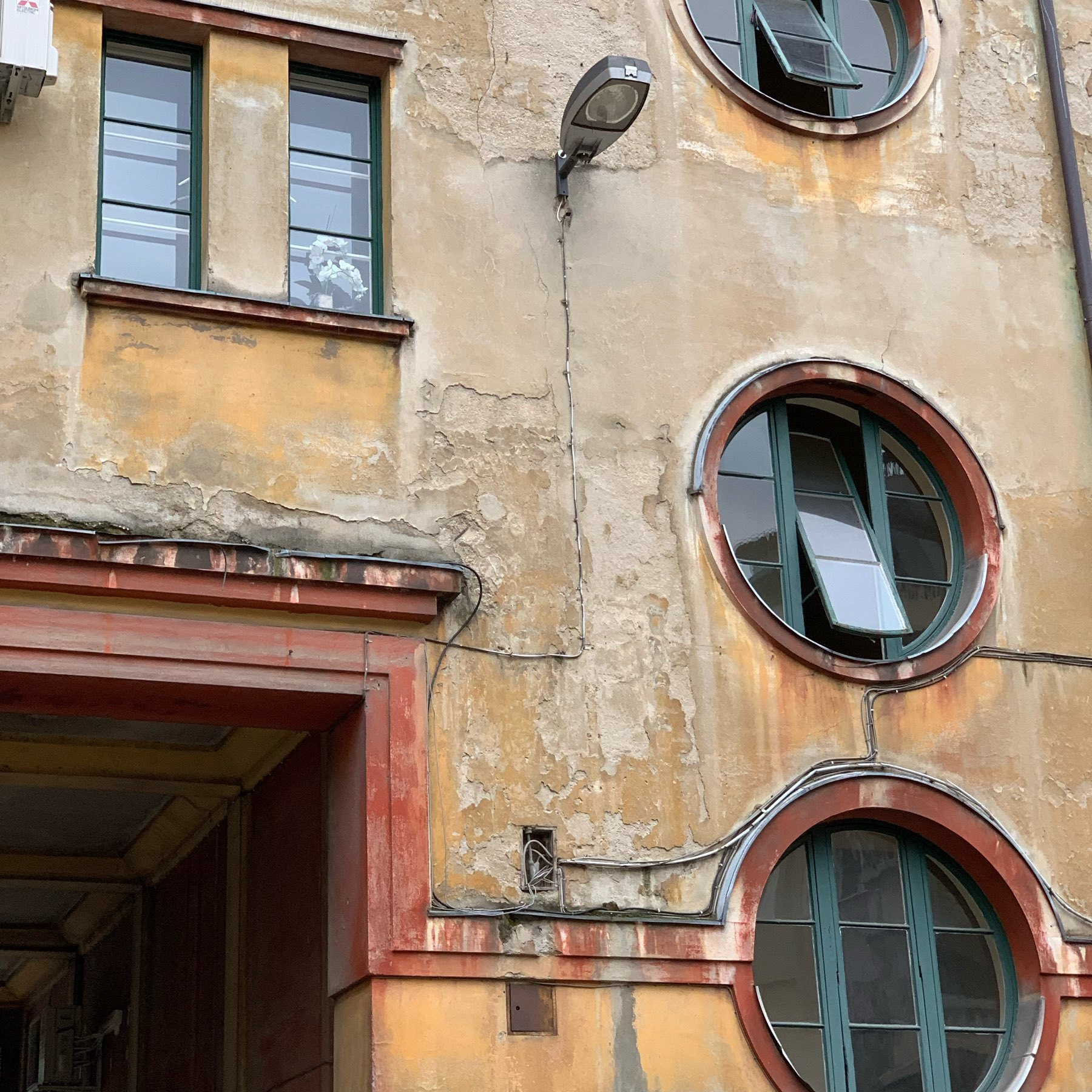 unusual round windows in old apartment block