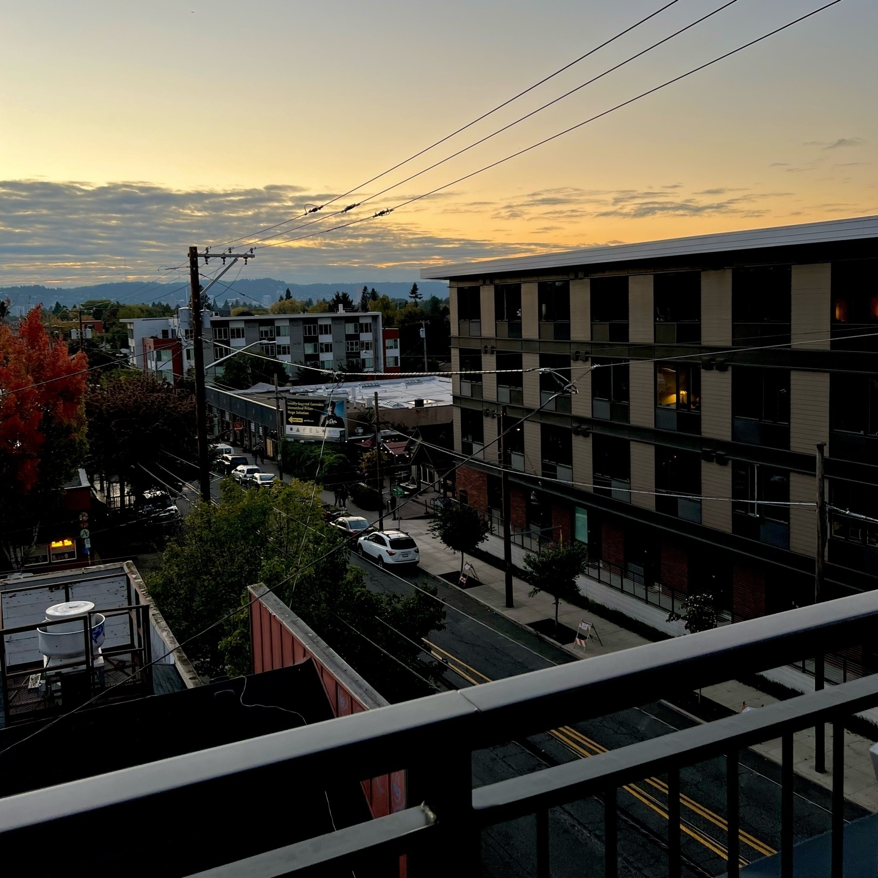 View of Portland's West Hills and Division Street at twilight