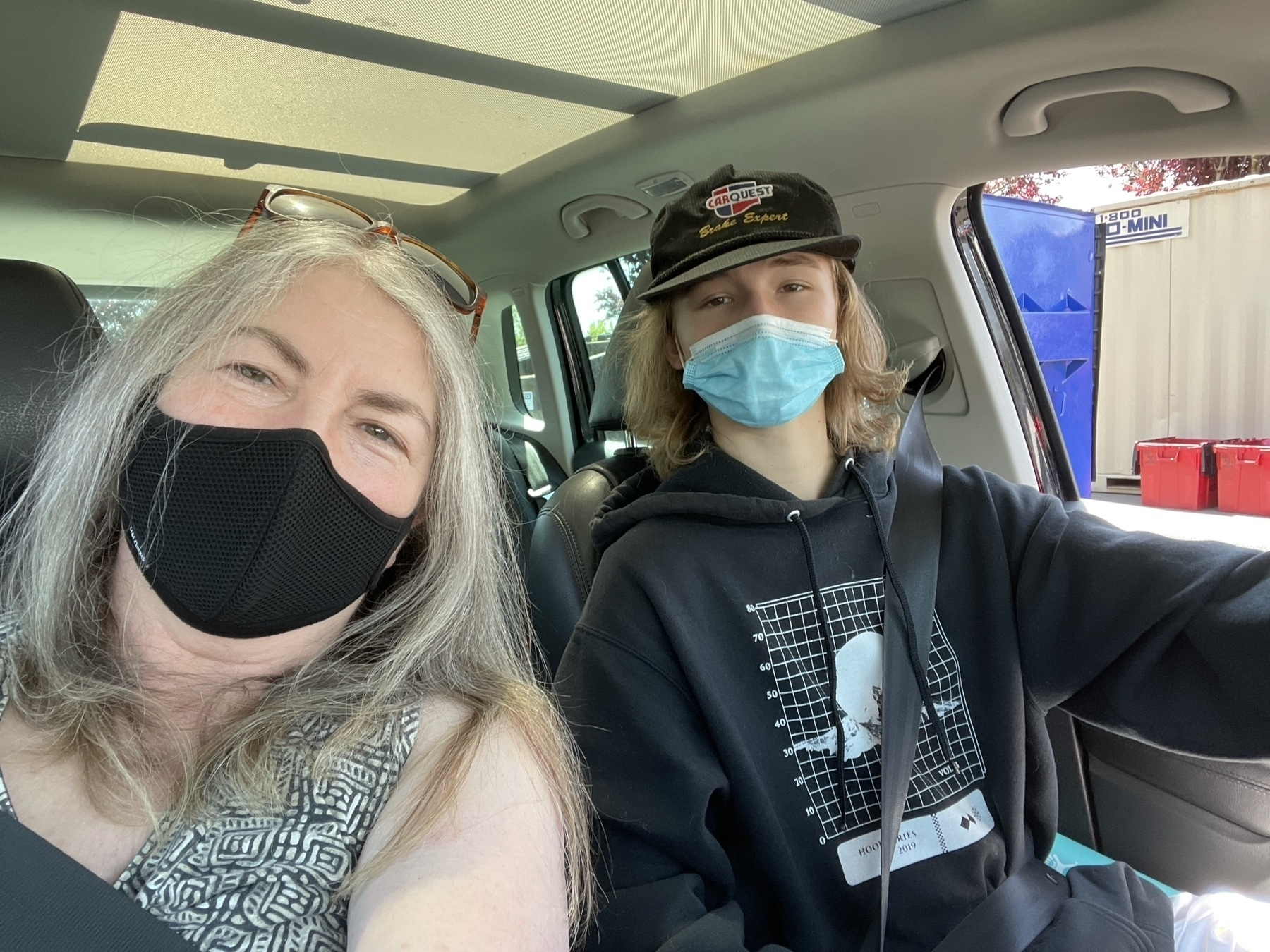 Teenage nephew drives middle-aged aunt to get their second vaccine shots.