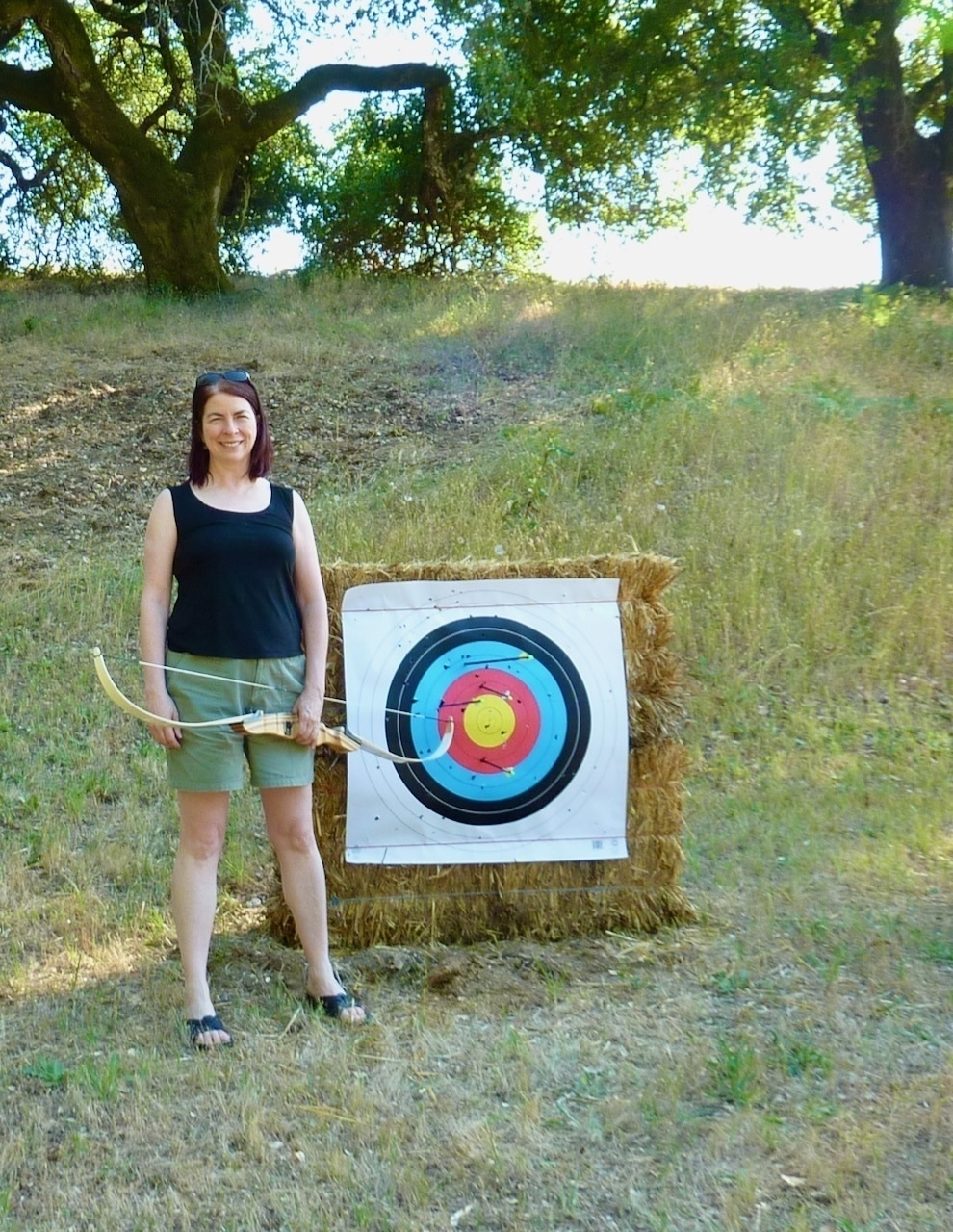 Me standing next to an archery target.