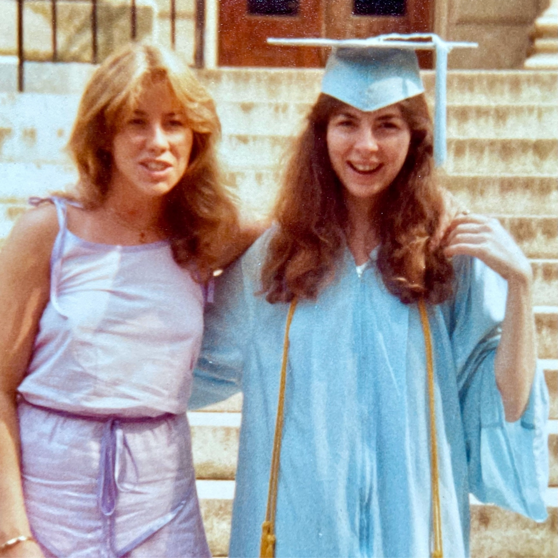 Me in blue graduation gown with my sister